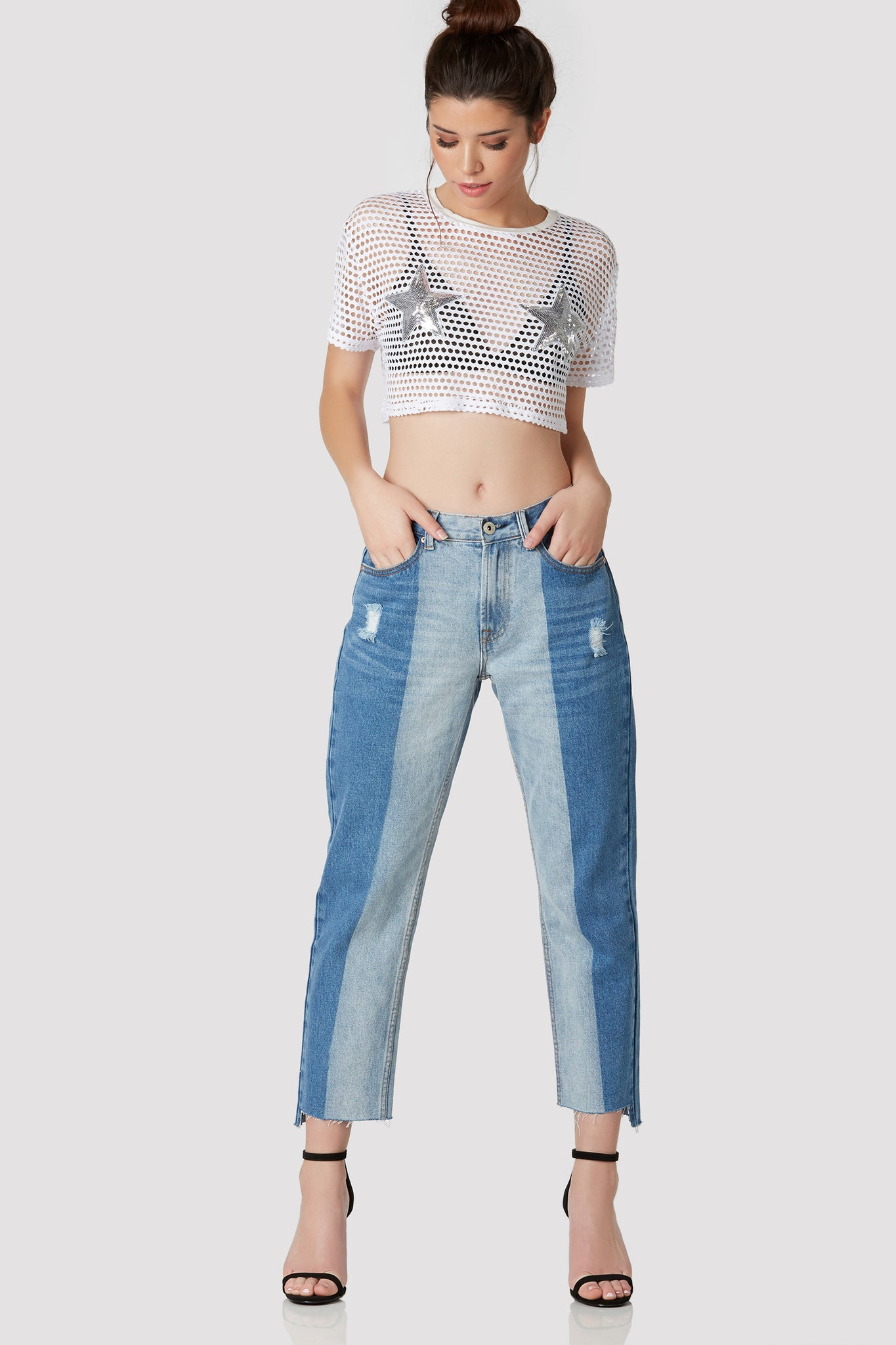 Trendy oversized fishnet T-shirt with contrast crew neckline and cropped hem. Sequin star patches in front for added detail.