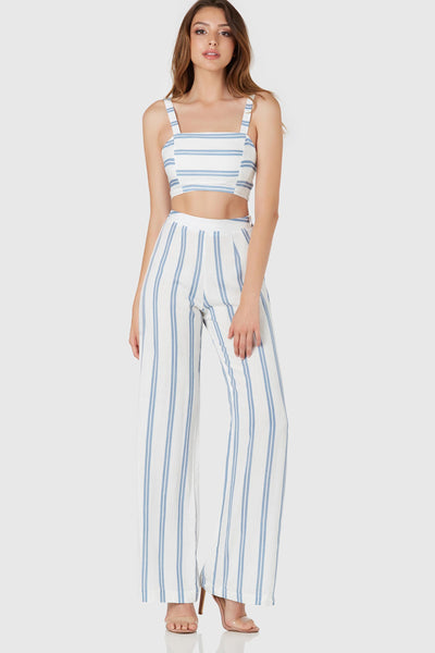 Chic high rise pants with stripe patterns throughout. Elasticized waist with hidden side zip closure.