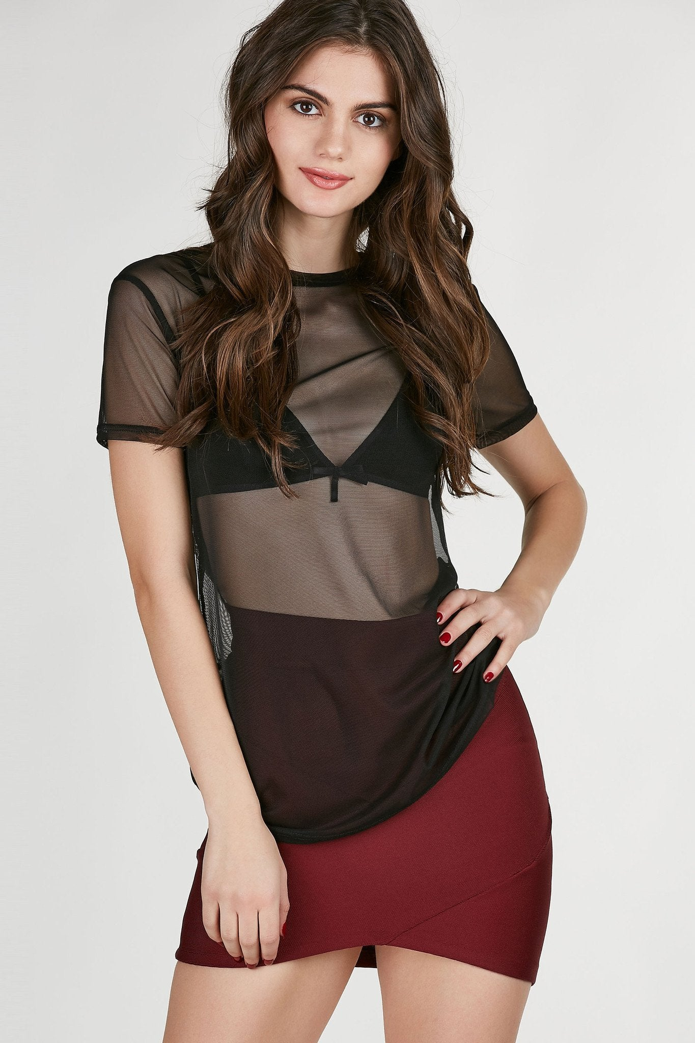 Round neck short sleeve top made of lightweight mesh material. Relaxed fit with straight hem all around.