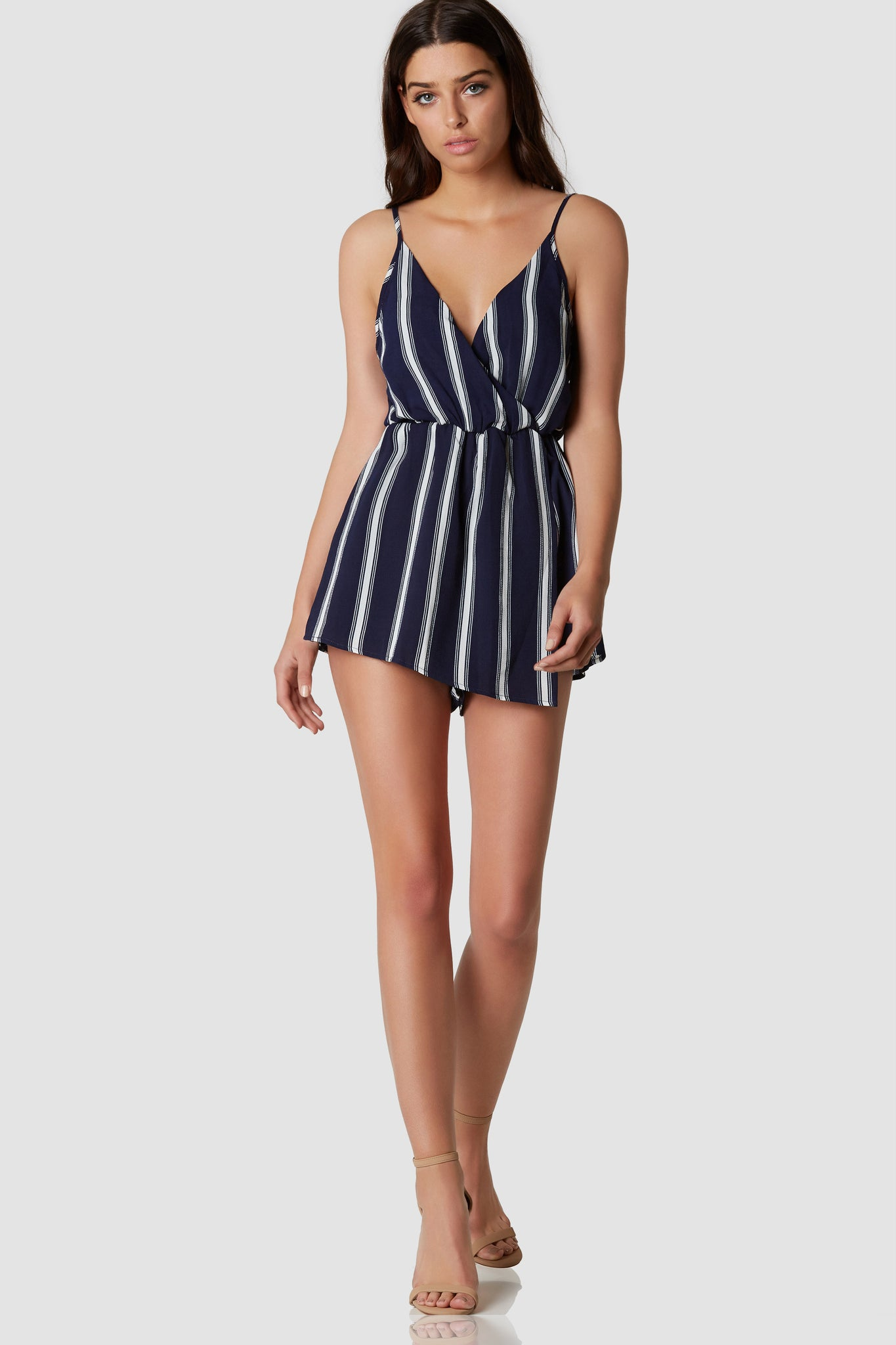 Fully lined spaghetti strap romper with overlap V-neckline. Stripe patterns throughout with front wrap design.