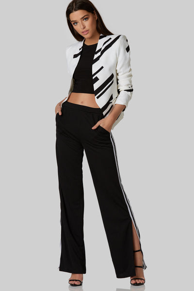 Chic collarless blazer with black stripes throughout. Open front with slight padding at shoulders.