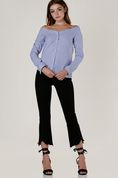 Chic boat neck button down with tripe patterns throughout. Elasticized band in back with curved hi-low hem.