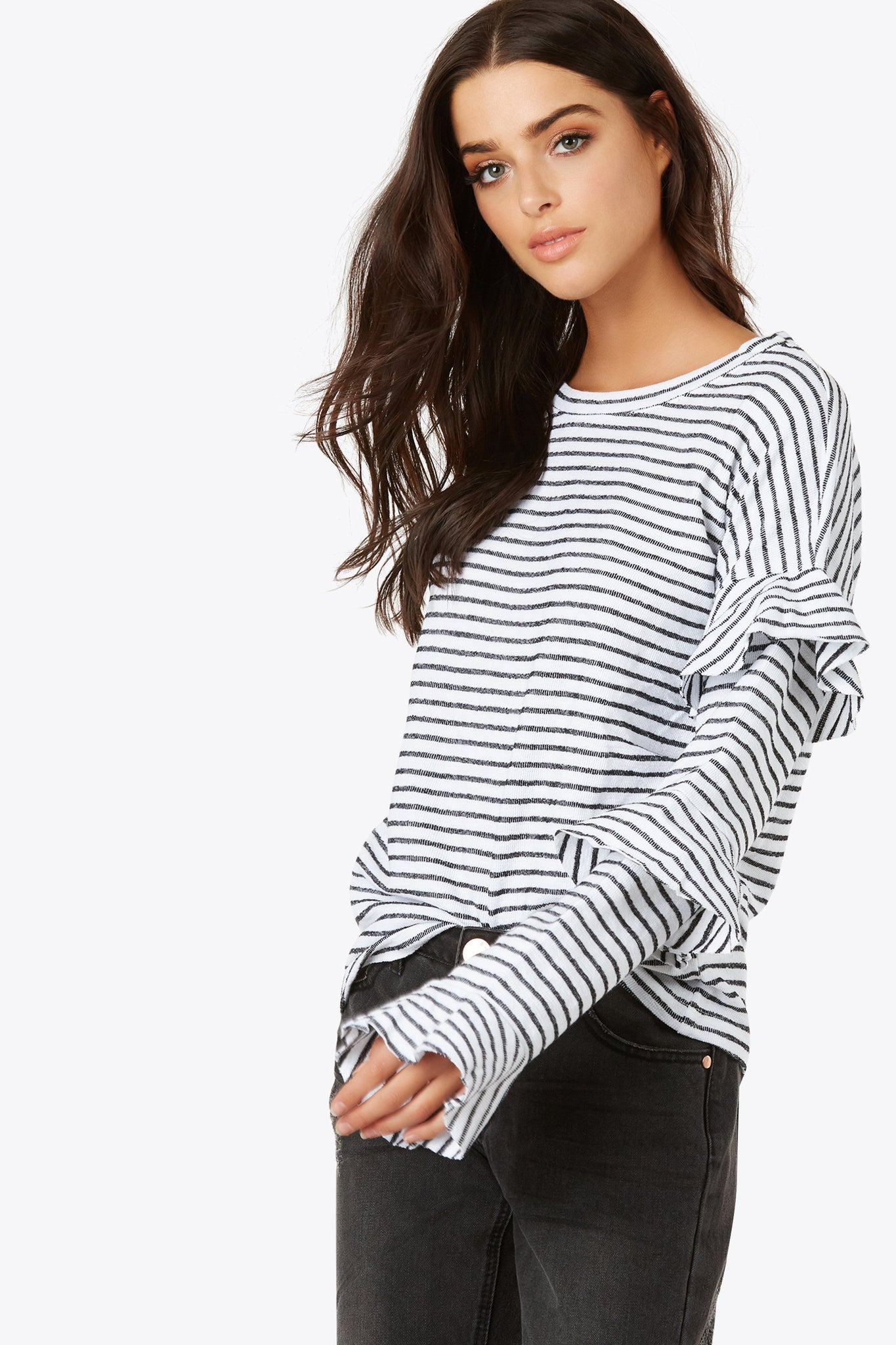 Add some stripes to your day with the relaxed fit knitted crewneck top. Tiered ruffle accents on sleeves.