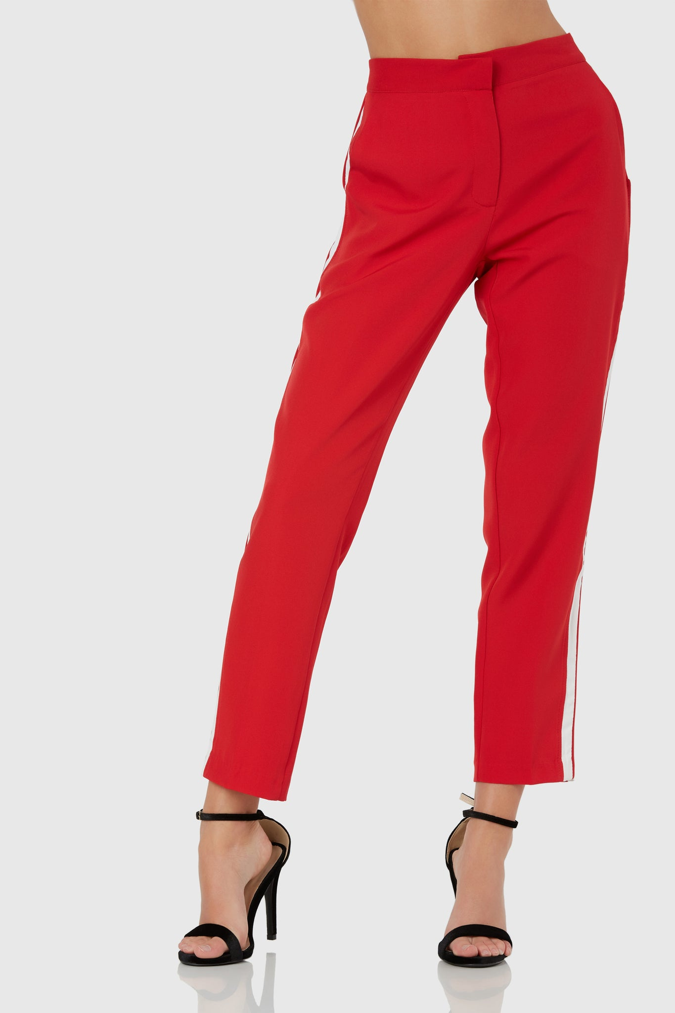 Trendy straight leg pants with contrast stripes down each side. Side pockets with front zip closure.