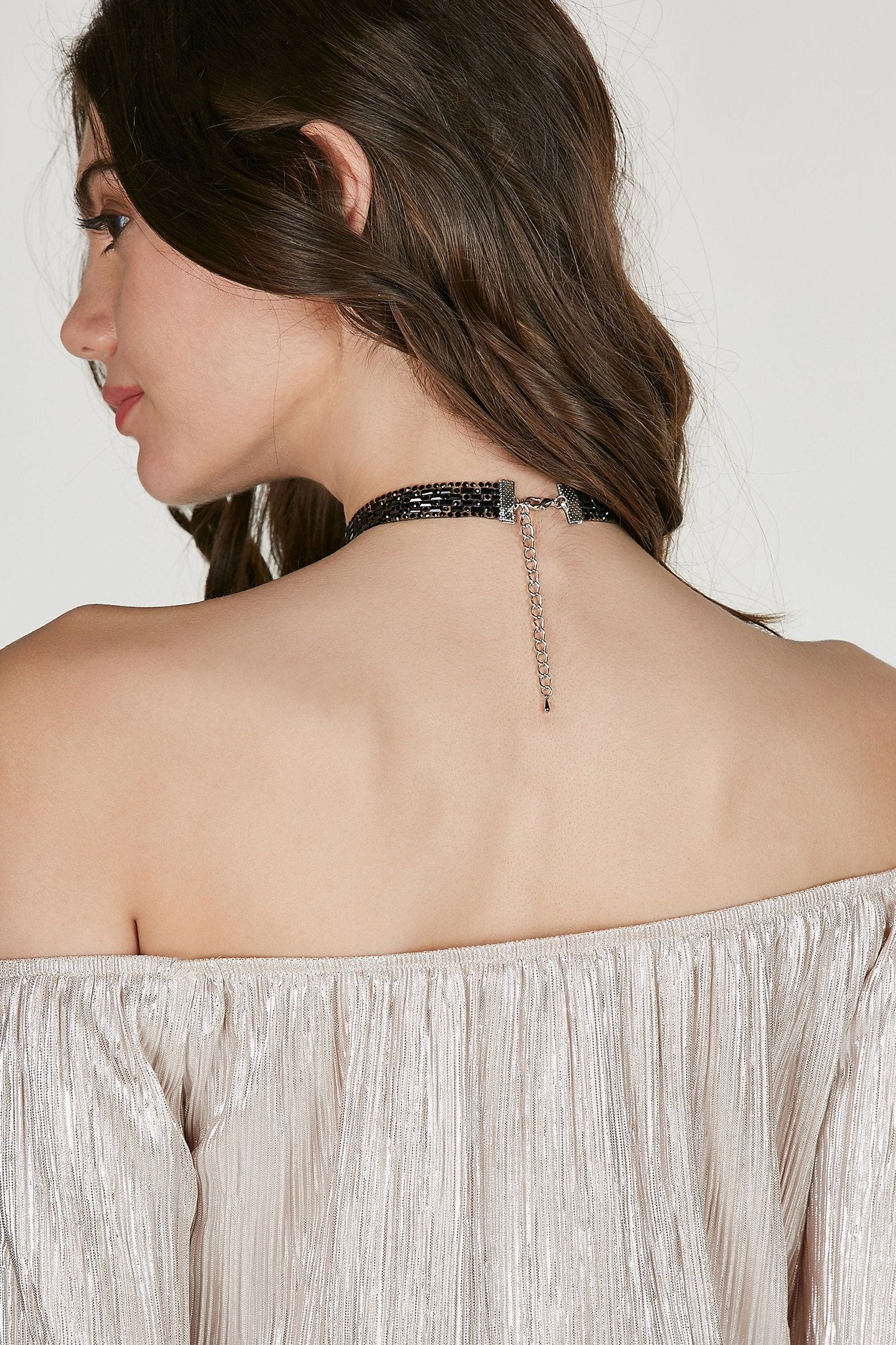Single band choker with faux gem studs throughout. Lobster clasp for fit and closure.