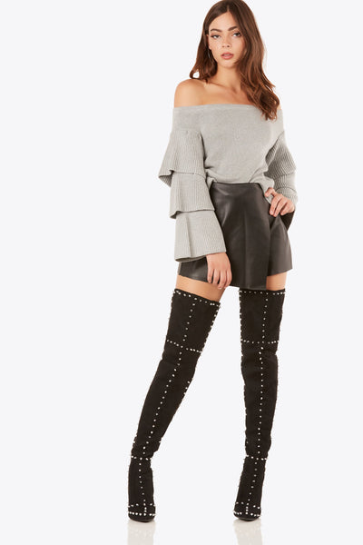 Bold pair of thigh high boots with soft suede-like finish. Sexy stiletto heels with pointed toe and stud detailing throughout.