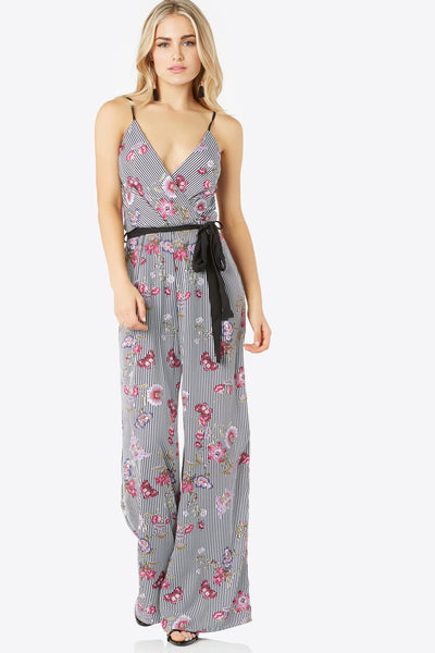 Printed jumpsuit with contrast spaghetti shoulder straps and waist tie detailing. Stripe and floral pattern throughout with wide leg fit.