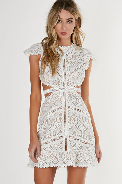Round neck short sleeve dress with flirty A-line hem and cut outs at waist. Open back with a button closure. Intricate crochet overlay with full lining.