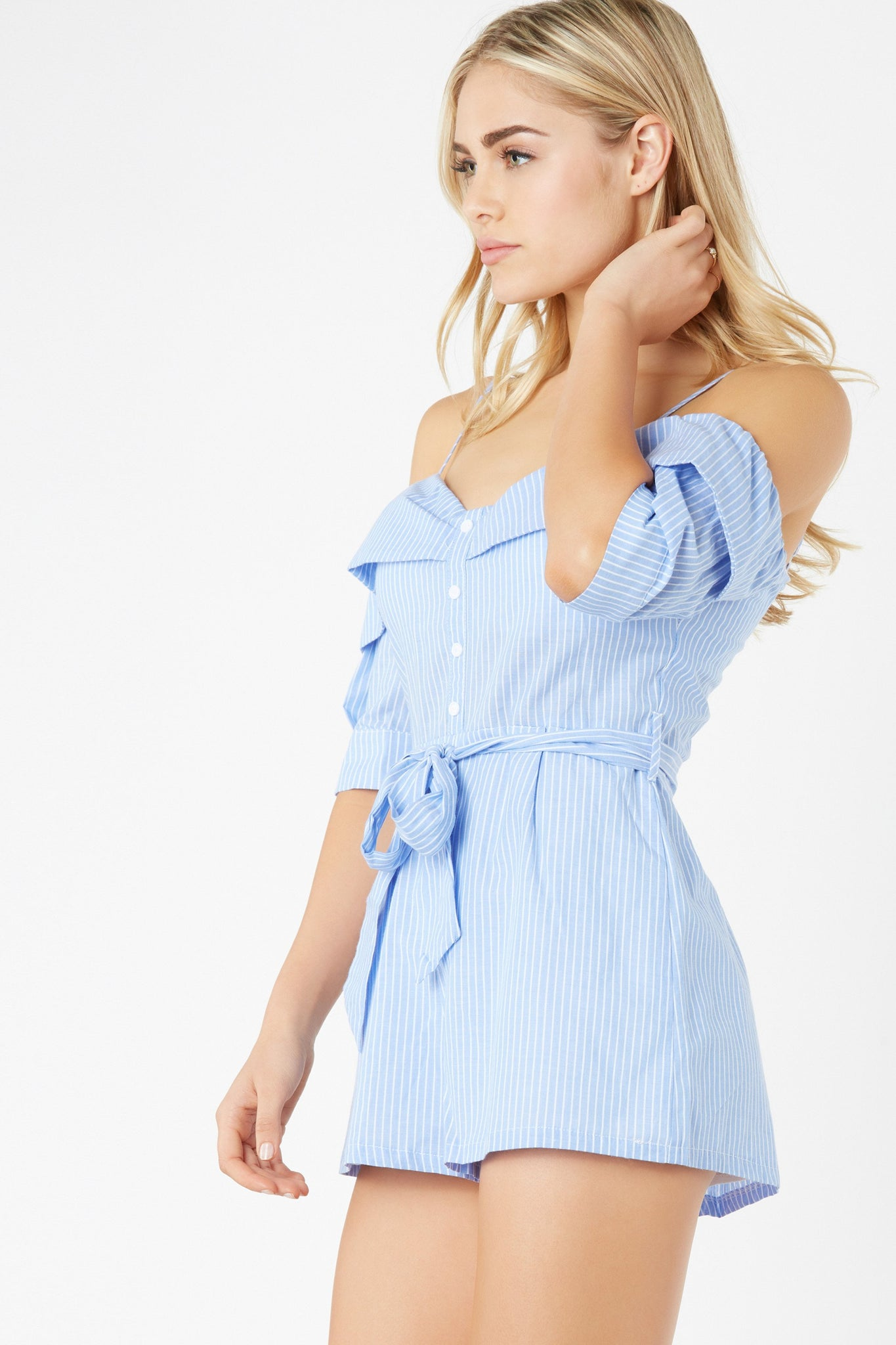 Flirty cold shoulder romper with pin stripe pattern throughout. Padded bust with sweetheart neckline and faux button detailing in front.