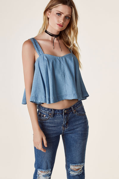 Flirty chambray sleeveless top with back zip closure and cropped, A-line finish.