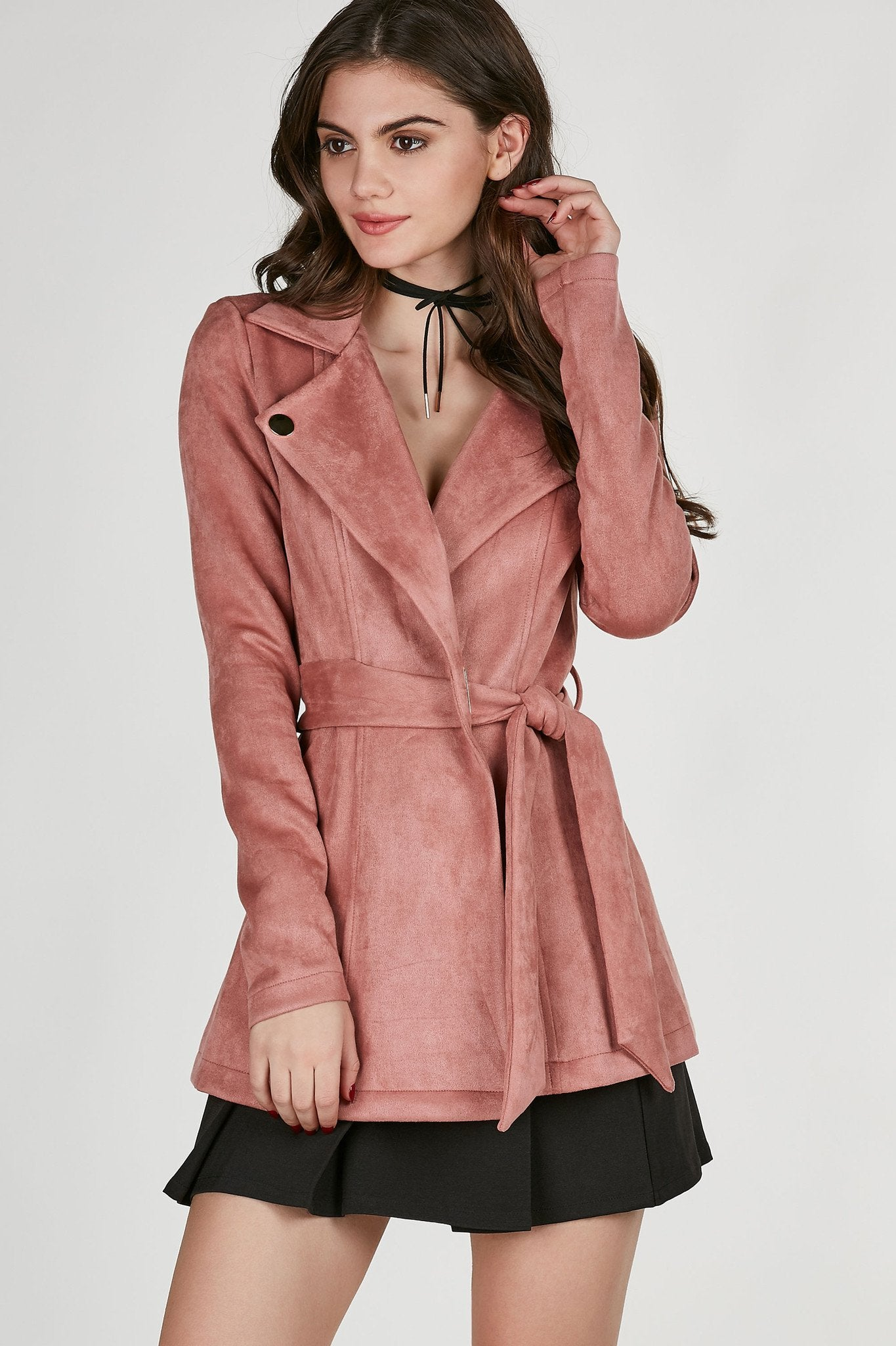 Chic trench style coat with soft suede finish. Bold lapels with gold hardware detailing and waist tie for closure.