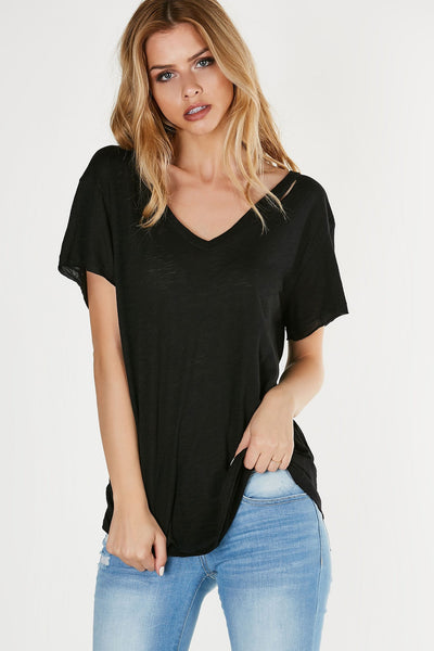 Plain oversized T-shirt with single slit at neckline for added detail. Soft lightweight material with straight, longline hem finish.