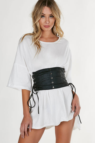 Trendy waist belt with shiny finish and back zip closure. Button detailing at center with lace up design on each side.