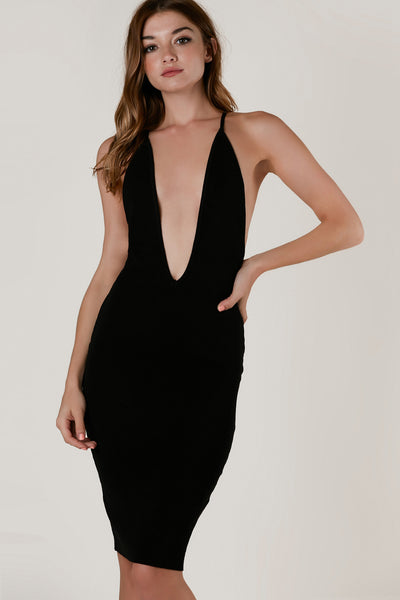 Sexy sleevless midi dress with plunging V-neckline. Bold open back with criss cross design and bodycon fit.
