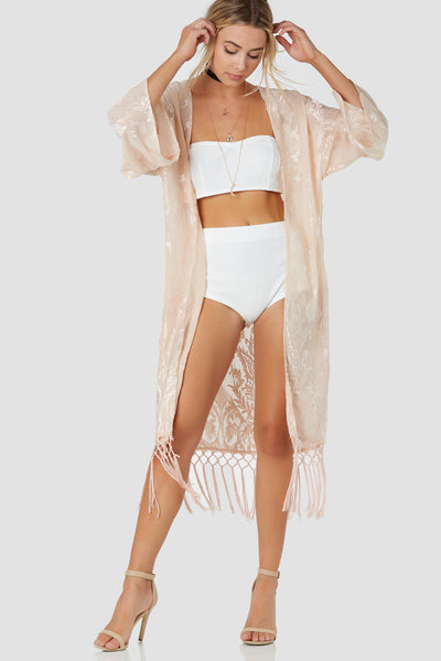 Elegant open front kimono with detailed floral embroidery throughout. Longline hem with fun tassel trim detailing.