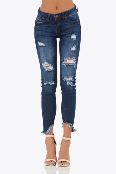 Own these must-have 5-pocket jeans asymmetrical hem line. Distressed accents throughout.