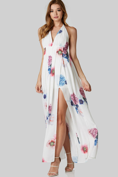 Stunning sleeveless maxi dress with halter V-neckline and open back. Lined with flowy overlap hem.