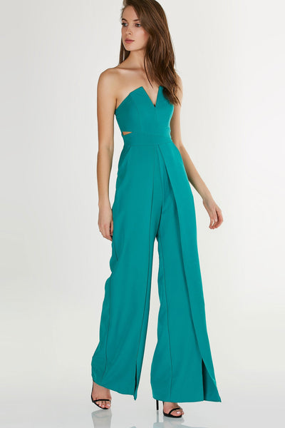 Stylish strapless jumpsuit with wired bust and trendy cut outs. Envelope style design with open slits on each leg for added detail.
