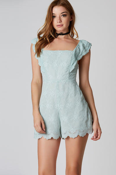 Flirty sleeveless romper with scalloped hem all around. Intricate embroidery throughout with cut out in back.
