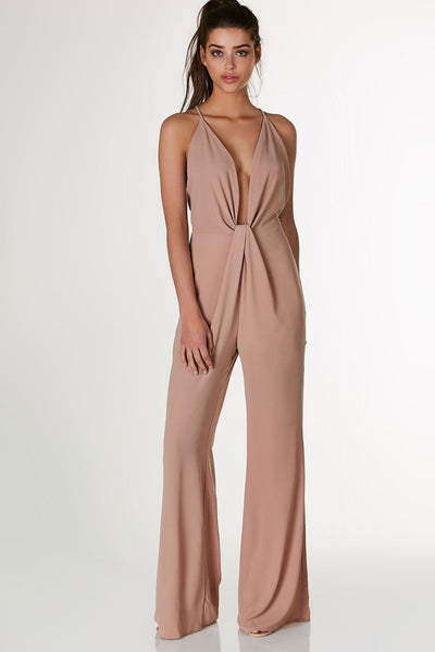 Sleeveless jumpsuit with plunging V-neckline and front knot detailing. Open back with strappy design and wide leg fit.