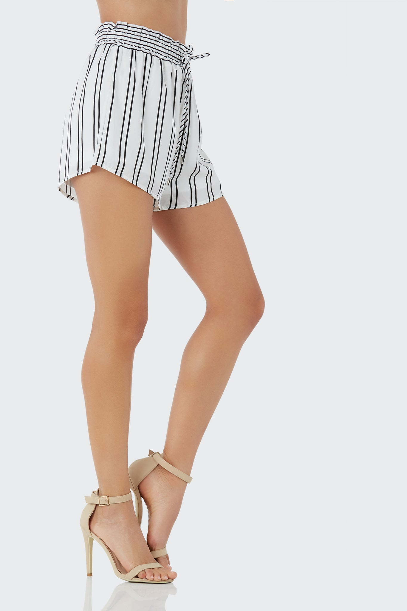 Flirty high rise shorts with stripe patterns throughout. Fully lined with drawstring at waist for fit.