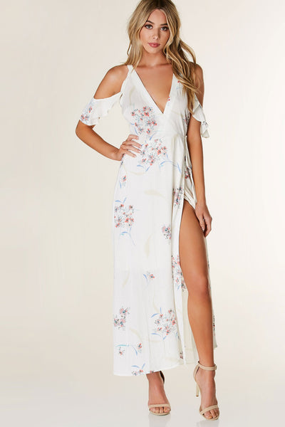 Flowy floral printed maxi dress with chic wrap design and deep V-neckline. Flirty ruffle sleeves with cold shoulder cut out and lining at bottom.