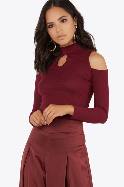 Add to your daily look with this long sleeve high neckline top. Cut out on center of bodice and shoulder.