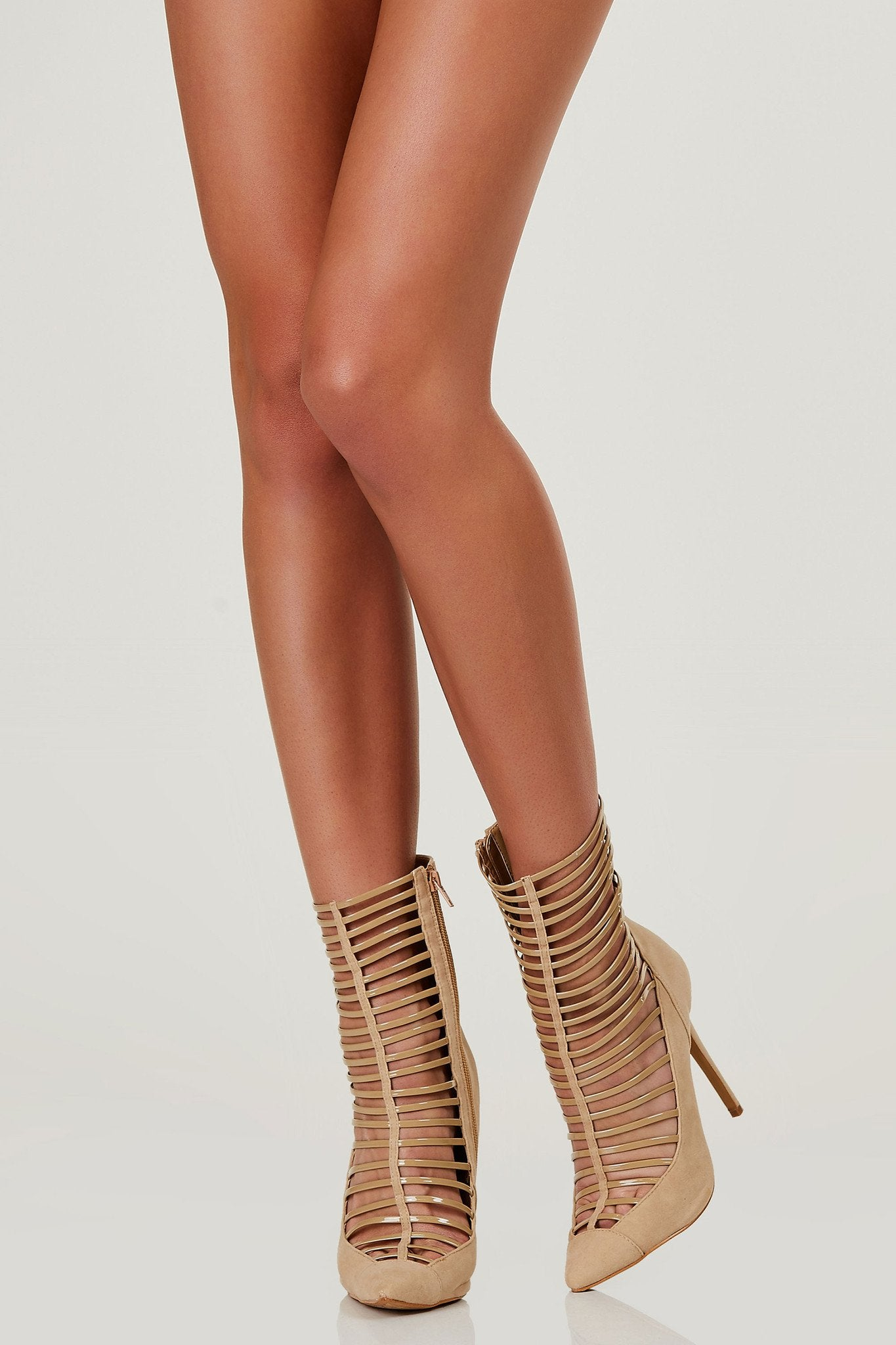 Chic pointed toe pumps with suede finish. Contrast caged cut out in front with side zip closure.