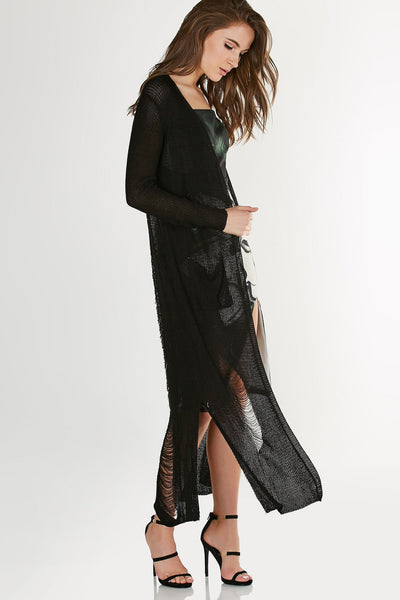 Classic knit long sleeve cardigan with flowy longline hem. Intense shredded detailing down the center back.