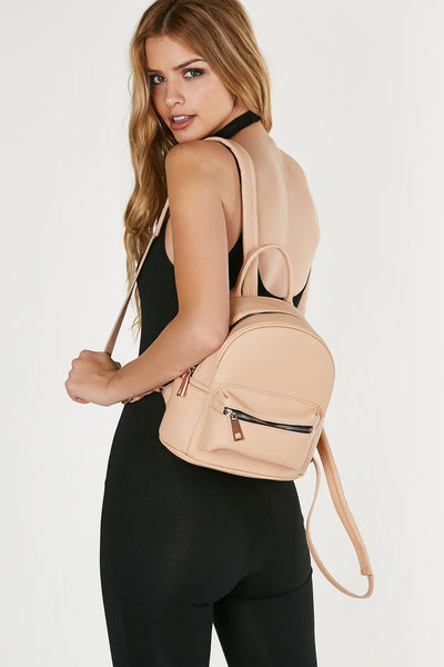 Structured mini backpack with textured faux leather finish and adjustable shoulder straps.