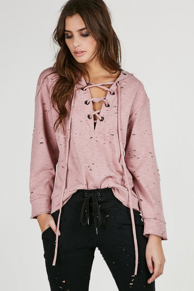 Oversized distressed hoodie with open lace up front and silver hardware eyelet detailing. Comes in a set with matching bottoms sold separately.