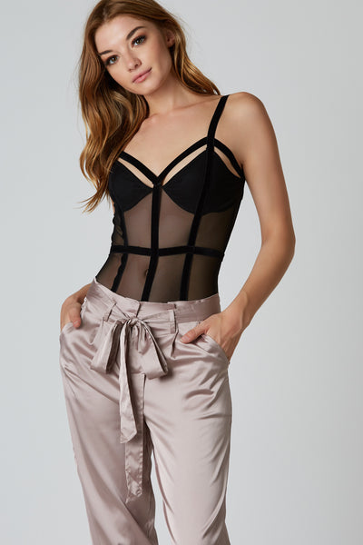 Sexy sleeveless mesh bodysuit with contrast velour strap detailing. Scooped back with cheeky cut and snap button closure.