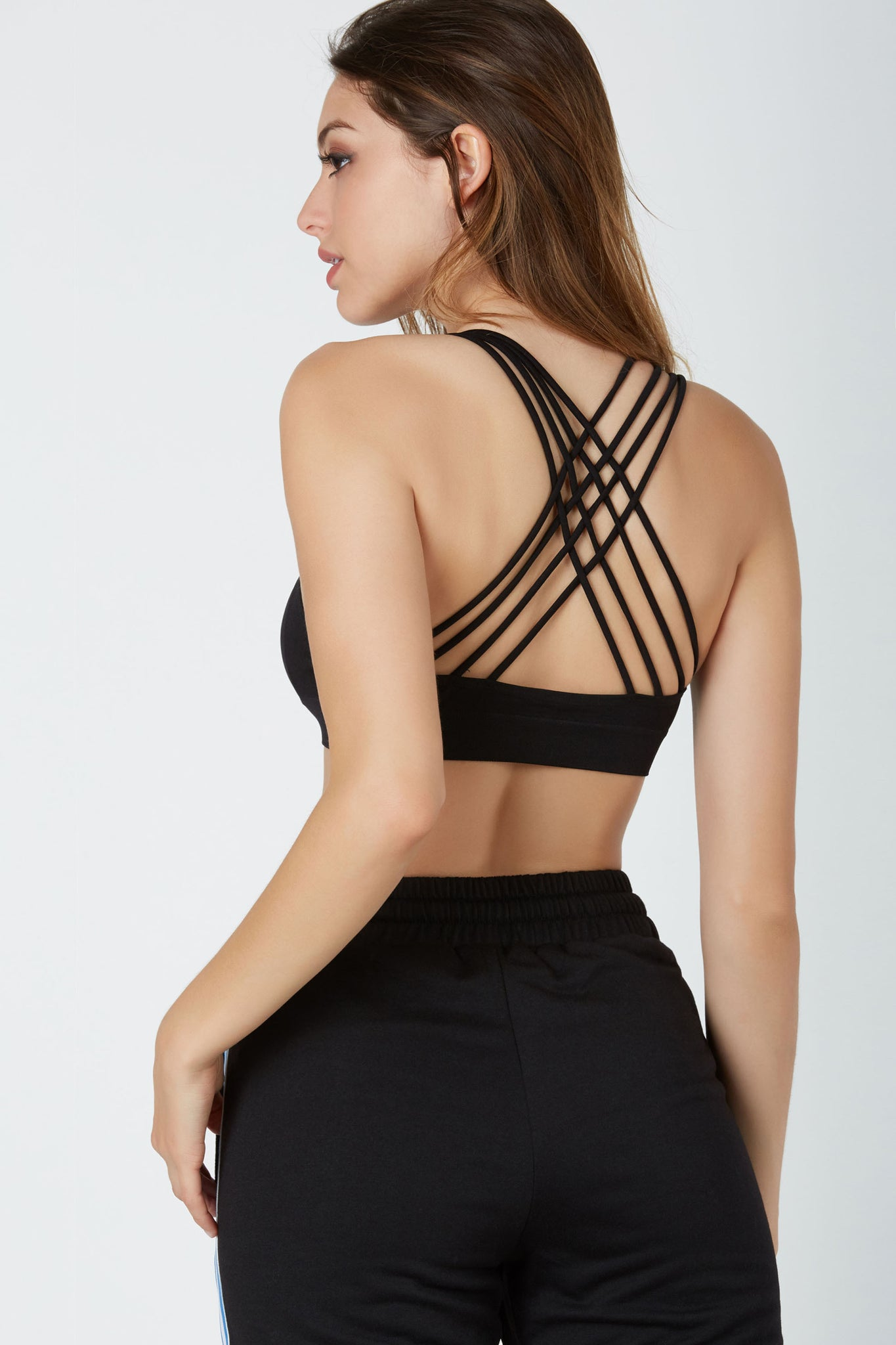 Comfortable stetchy bralette with classic V-neckline. Open back with strappy caged design.