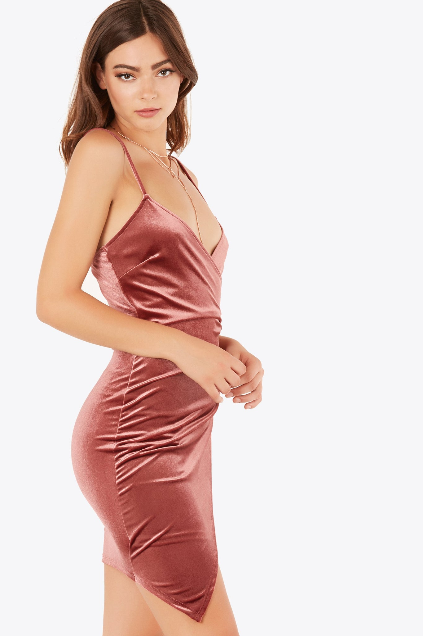 Flattering sleeveless dress with wrap design. Ruching on one side with asymmetrical enveope hem and velour finish.