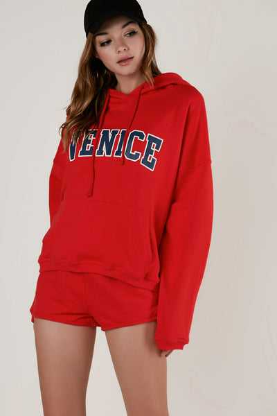 Comfortable oversized graphic hoodie with drawstrings at neck. Ribbed hem with front pocket detailing.