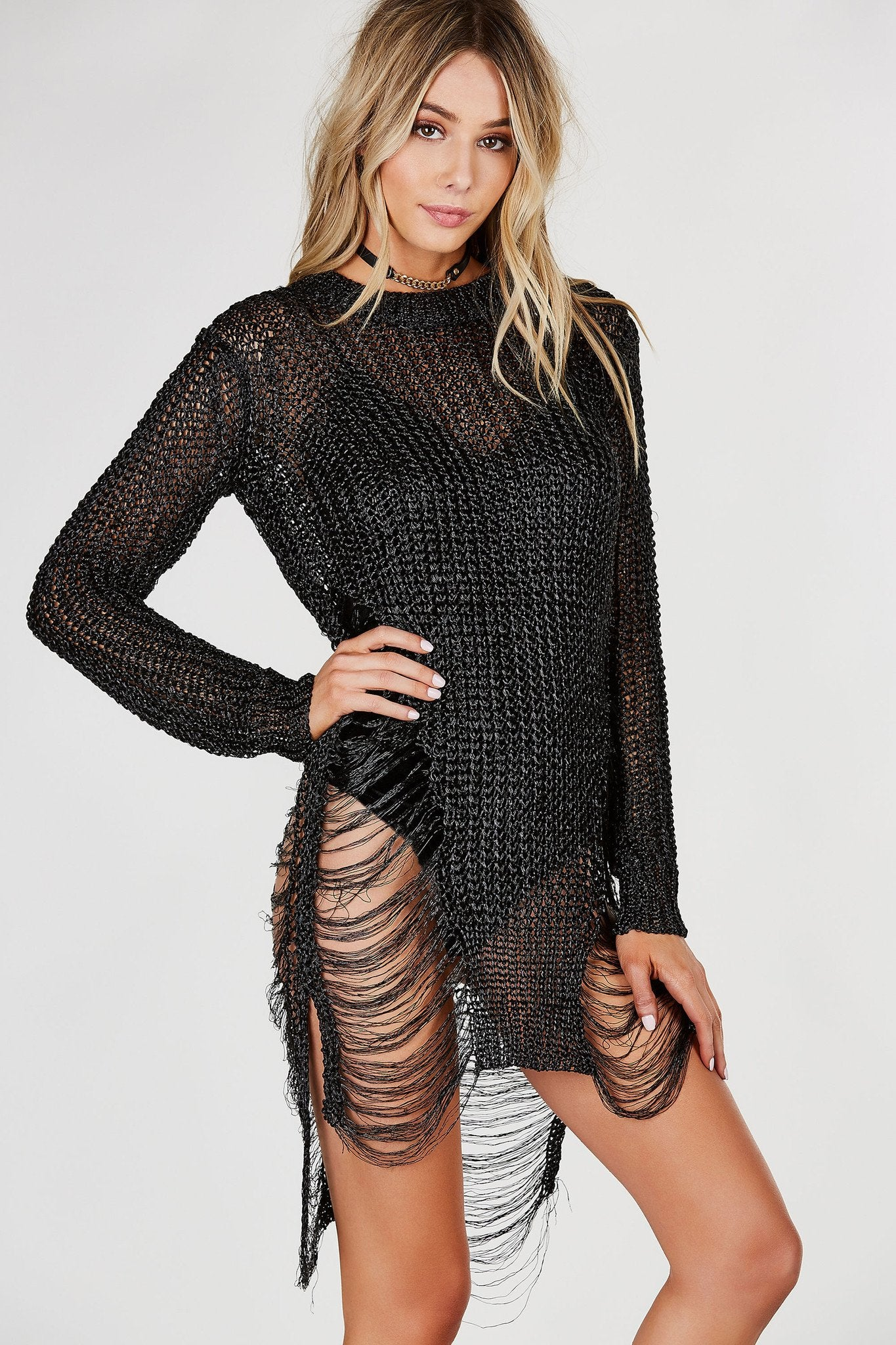 Crew neck loose knit tunic with metallic finish. Shredded detailing with relaxed fit.