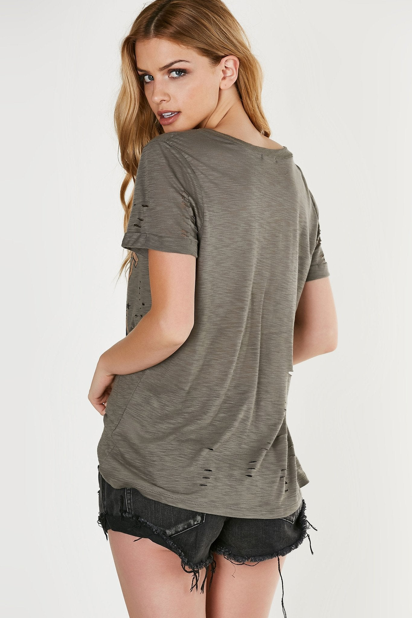 V-neck oversized T-shirt with distressing throughout. Bold graphic in front with longline hem.