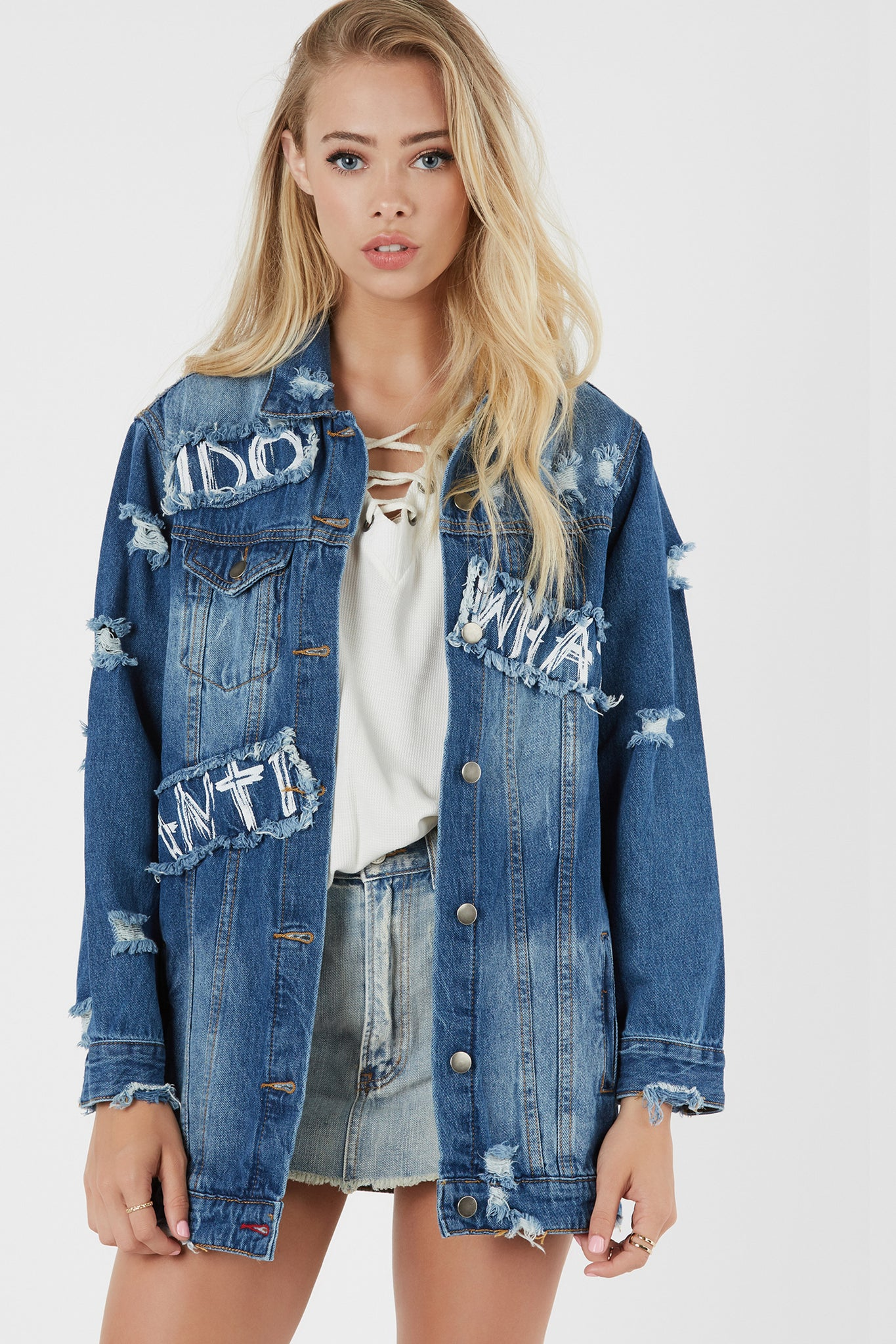 Trendy oversied denim jacket with distressing throughout. Graphic print with longline hem finish.