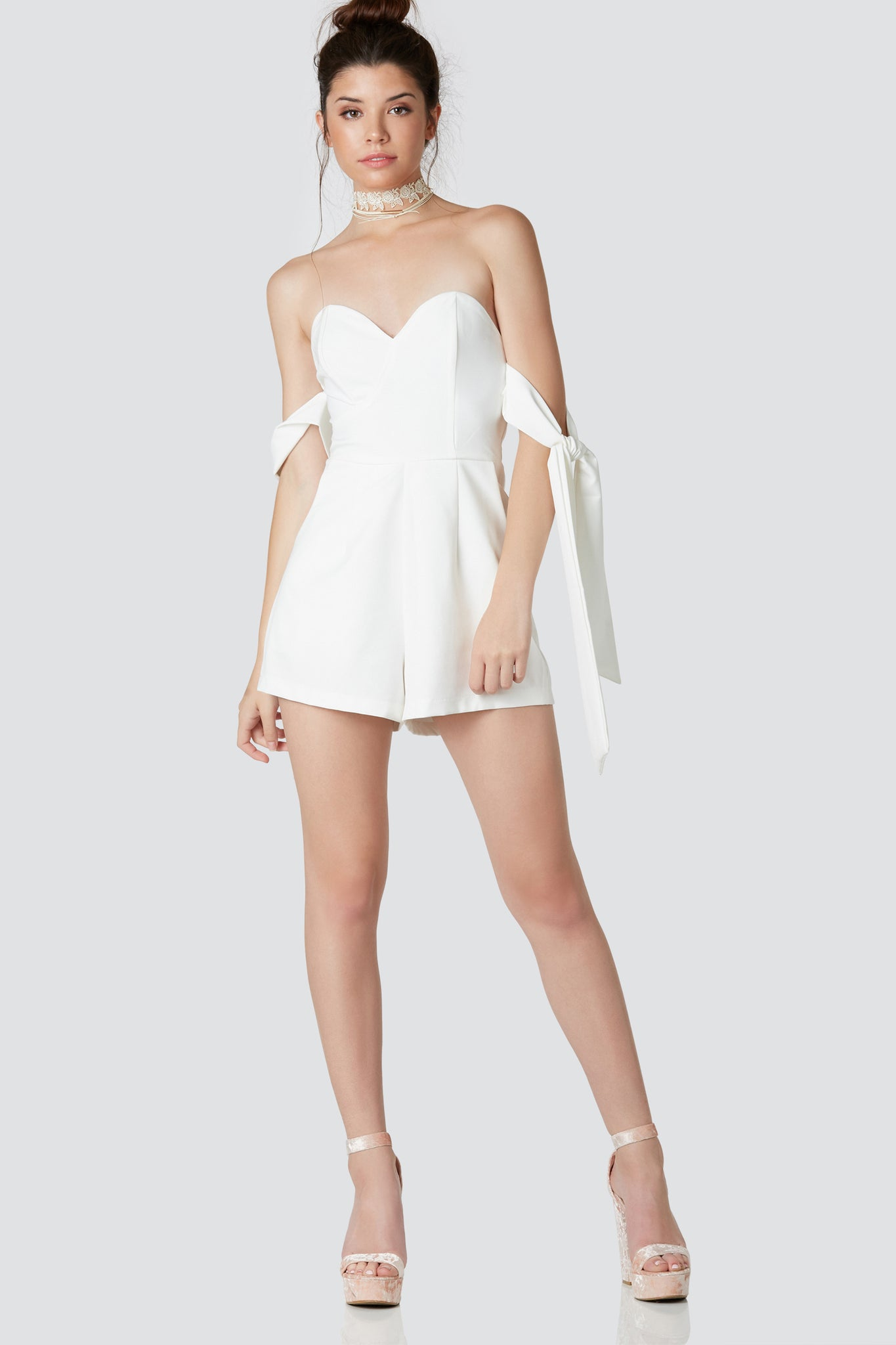Flirty off shoulder romper with sweetheart neckline and tie up sleeves. Fully lined with back zip closure.