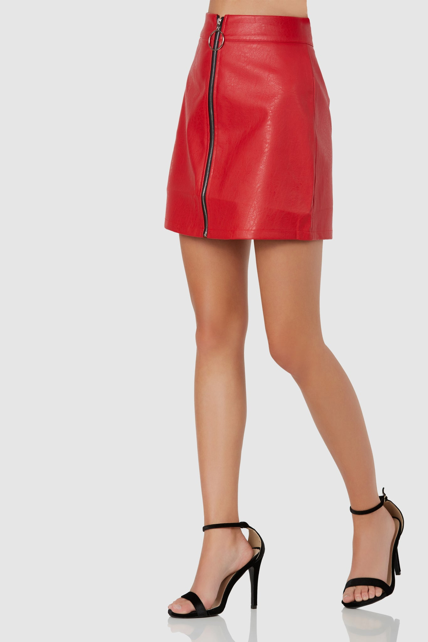 Stylish A-line mini skirt with faux leather exterior. Front contrast zip closure with hoop detailing.