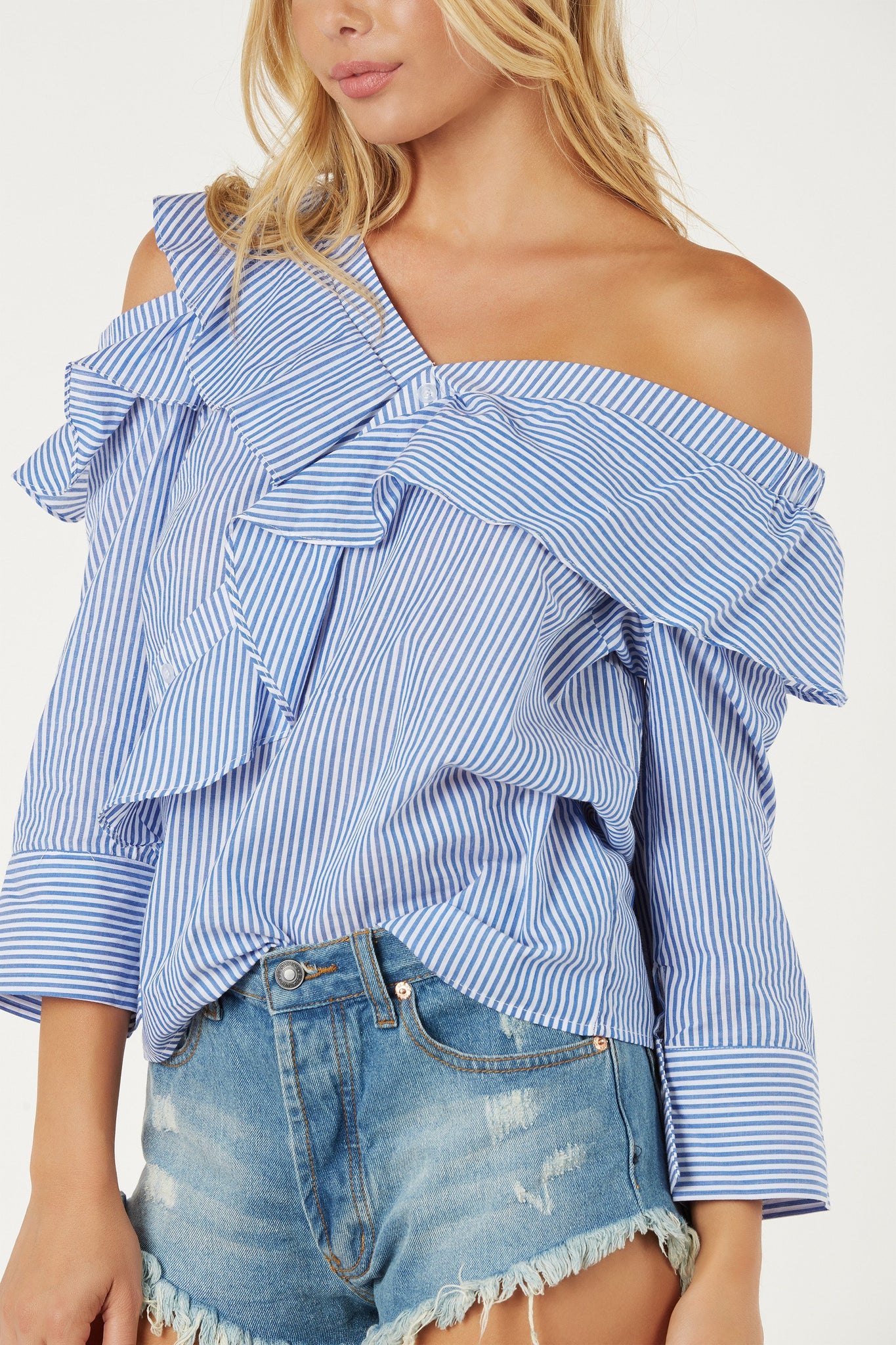 Chic ruffled blouse with faux button detailing. Cold shoulder cut out with pin stripe pattern throughout.