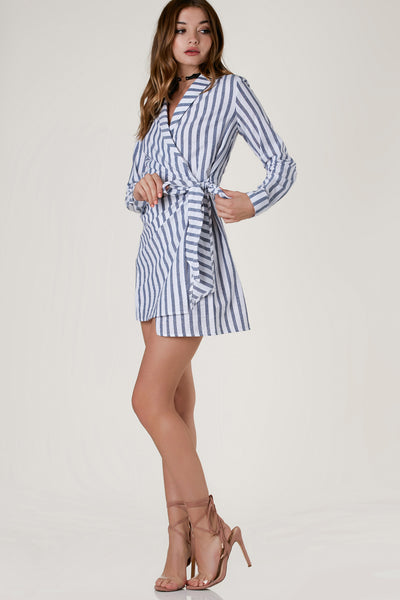 Chic collared mini dress with nautical stripe patterns throughout. Open front with wrap closure that ties on one side.