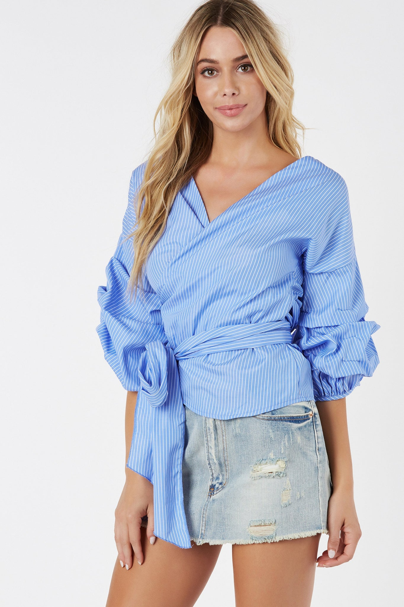 Chic V-neck wrap blouse with pin stripe pattern throughout and structured sleeves.