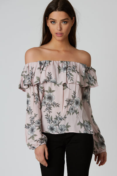 Lightweight off shoulder top with elasticized neckline for comfortable fit. Long sleeves with floral print throughout.