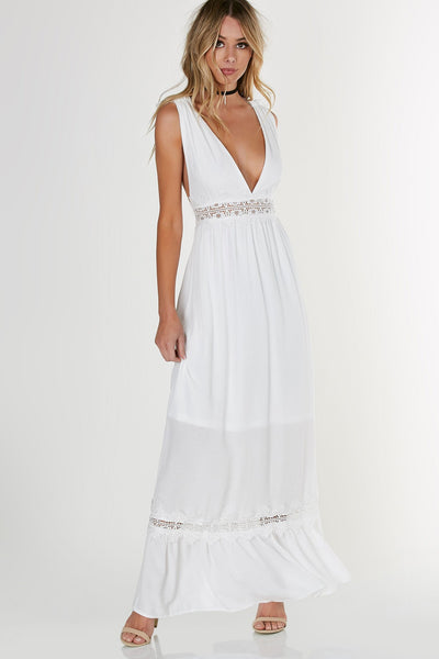 An elegant deep V maxi dress with intricate crochet detailing. Flowy hem with scooped, open back.