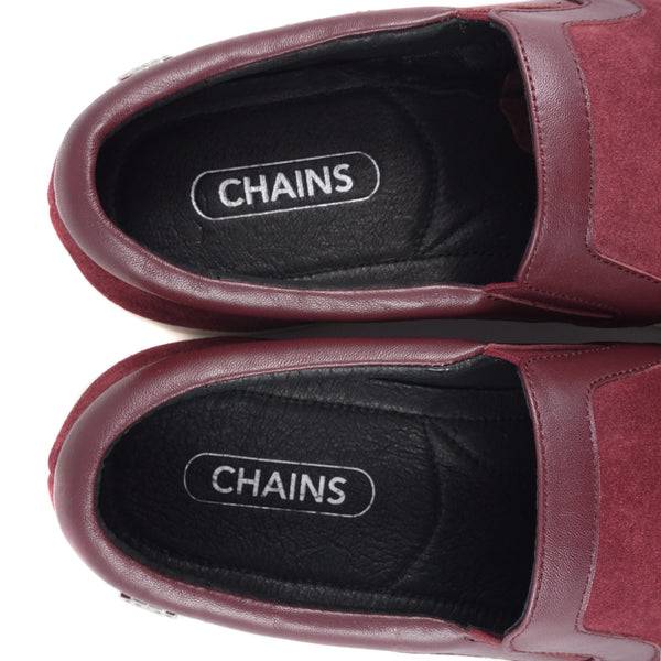 Burgundy cow suede slip-on slide sneaker from CHAINS with signature metal badge on the side