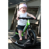 Strider 12 Sport Baby Bundle in Green in action