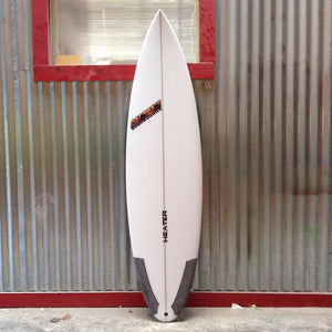 high performance rounded pin tail surfboard