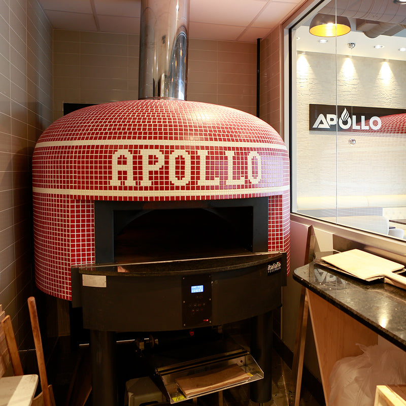 A red Napoli fired oven with a custom branded tiling for Apollo.
