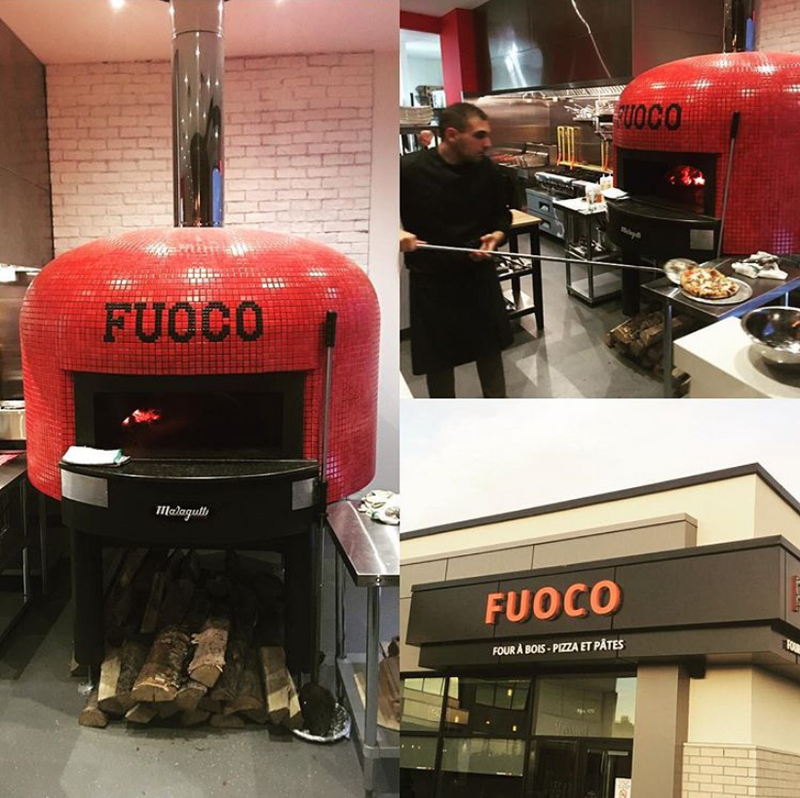 A bright red Napoli fired oven with a custom branded tiling for Fuoco.